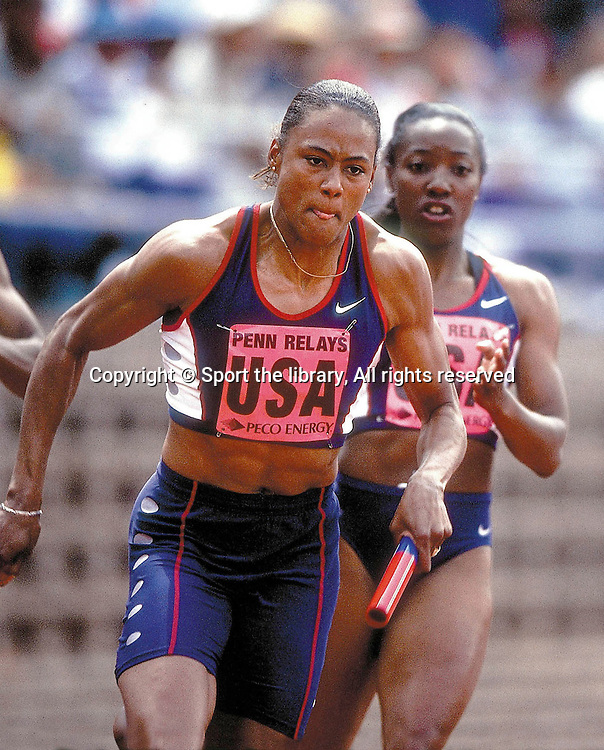 &copy; Sport the library/Heinz Kluetmeier/SI<br /> Track &amp; Field-2000 Penn Relays 2000<br /> Inger Miller, USA passes the baton to Marion Jones in the final leg on the 4x100m relay race. <br /> X60223