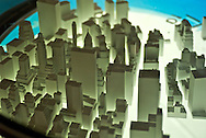 New York. American Museum of Natural Histoty. Exhibiiton on Climate Change: The Threat to Life and A New Energy Future. A model of Manhattan in the Climate Change  exhibition shows the effect of rising sea levels. The model you see here doesn't predict the future--but it does illustrate one possible outcome of polar ice sheet meltdown. It shows the southern end of Manhattan Island, a borough currently home to more than 1.5 million people, under 3 and 5 meters (about 10 and 16 feet) of sea-level rise. The higher amount would occur if a significant part of the ice sheets in Greenland or Antarctica melted--a scenario experts consider unlikely to happen anytime soon.