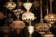 Engines of old and rusty ceiling fans hang in a repair shop. Hanoi, Vietnam, Asia