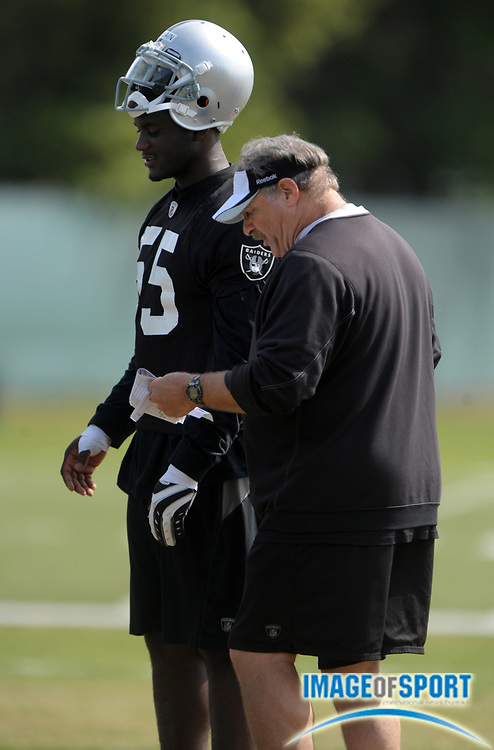 May 26, 2010; Alameda, CA, USA; Oakland Raiders linebackers coach Mike Haluchak (right) talks with rookie linebacker Rolando McClain (55) at organized team activities at the Oakland Raiders practice facility.