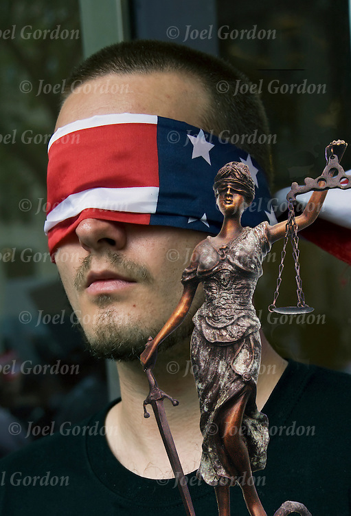 Justice in America, college of two image.<br /> <br /> Demonstrator wearing an American flag (justice is blind) covering his eyes near ground zero on 9-11-11. <br /> <br /> The second image is of Lady or Blind Justice.<br /> <br /> Blindfold Flag - GOR-83214-11-cR<br /> Lady Justice - GOR-64520-08