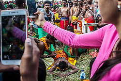 June 12, 2017 - Deli Serdang, North Sumatra, Indonesia - Tamil Hindu people of Indonesia puncture their body with iron hooks as prayer offerings during the Vaigasi Thiruvilla celebration at riverside, in Bulucina Village, Deli serdang on June 11, 2017, North Sumatra Province, Indonesia. The annual celebration is a Hindu religious ritual organized by Tamils ​​commemorated annually from June to August during the sixth month of the second week as a month of greatness for Tamil Hindus who is believed to be the perfect day to remember the greatness of the Goddess at the expense of their ring-bound bodies Iron and walking in embers, said a Tamil priest, Janu. (Credit Image: © Ivan Damanik via ZUMA Wire)