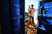 Families try to recover after a massive earthquake in India in 1999.