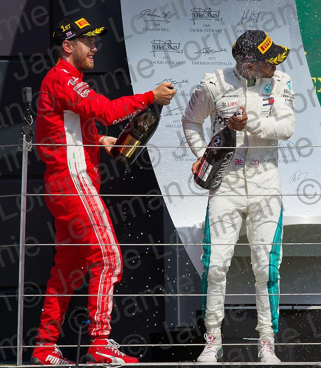 The 2018 Formula 1 F1 Rolex British grand prix, Silverstone, England. Sunday 8th July 2018.<br /> <br /> Pictured: Scuderia Ferrari driver Sebastian Vettel celebrates winning as Mercedes AMG Petronas driver Lewis Hamilton finishes second in the British Formula 1 Grand Prix at Silverstone.<br /> <br /> Jamie Lorriman<br /> mail@jamielorriman.co.uk<br /> www.jamielorriman.co.uk<br /> 07718 900288
