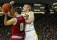 December 31 2012: Indiana Hoosiers forward Will Sheehey (0) and Iowa Hawkeyes forward Aaron White (30) battle for a rebound during the first half of the NCAA basketball game between the Indiana Hoosiers and the Iowa Hawkeyes at Carver-Hawkeye Arena in Iowa City, Iowa on Monday December 31, 2012. Indiana defeated Iowa 69-65.
