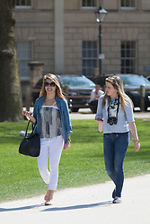 © Licensed to London News Pictures. 20/04/2015. Bristol, Avon, UK. Two women out enjoying the sunny weather in Queen's Square in Bristol today, 20th April 2015. The South West of England is set for more warm temperatures and plenty of sunshine this week. Photo credit : Rob Arnold/LNP