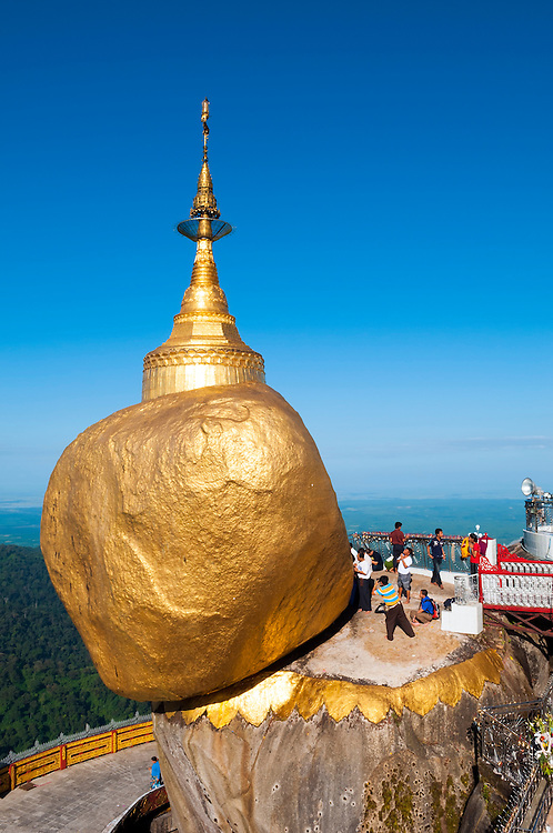 A landmark site in Myanmar and the destination of many a Buddhist pilgrim, the Golden Rock (also called the Kyaiktiyo Pagoda) is famous for how it is precariously perched on the ledge. It is said that the rock is balanced on a hair of the Buddha. People gather beside the boulder to pray, take pictures, etc.