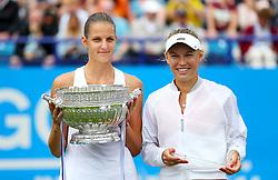 Czech Republic's Karolina Pliskova (left) celebrates winning against Denmark's Caroline Wozniacki in the Women's Singles Final during day nine of the AEGON International at Devonshire Park, Eastbourne.