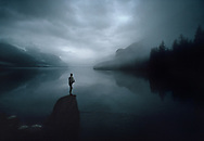 Alaska, Haines, Man Standing on Rock Fishing, Chilkoot Lake, Stormy clouds, gray
