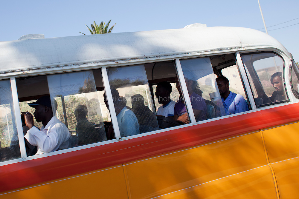 HAL FAR, MALTA - JUNE 21: Migrants take the 113 bus from Valletta to the Open centres in Hal Far (which translates as &quot;Rat's Town&quot;) on June 21, 2011.<br /> <br /> The Open Centres in Malta serve as a temporary accomodation facility, but they ended becoming permanent accomodation centres, except for those immigrants who receive subsidiary protection or refugee status and that are sent to countries such as the United States, Germany, Poland, and others. All immigrants who enter in Malta illegally are detained. Upon arrival to Malta, irregular migrants and asylum seekers are sent to one of three dedicated immigration detention facilities. Once apprehended by the authorities, immigrants remain in detention even after they apply for refugee status. detention lasts as long as it takes for asylum claims to be determined. This usually takes months; asylum seekers often wait five to 10 months for their first interview with the Refugee Commissioner. Asylum seekers may be detained for up to 12 months: at this point, if their claim is still pending, they are released and transferred to an Open Center.<br /> <br /> <br /> Gianni Cipriano for The New York Times