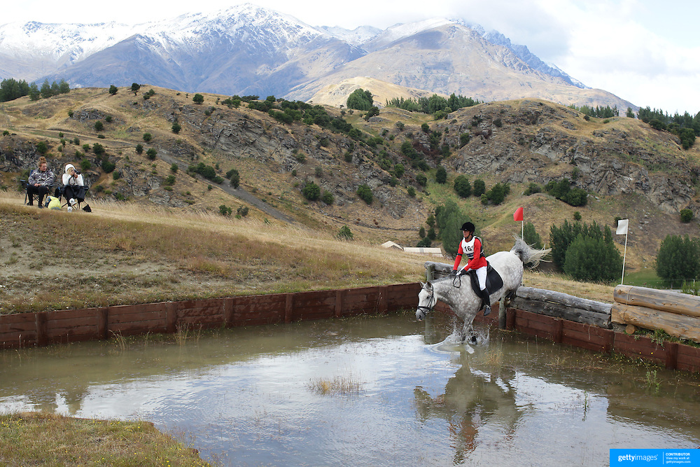Anna-Marie Chin riding Wilberforce in action at the water jump during the Cross Country event at the Wakatipu One Day Horse Trials at the Pony Club grounds,  Queenstown, Otago, New Zealand. 15th January 2012. Photo Tim Clayton