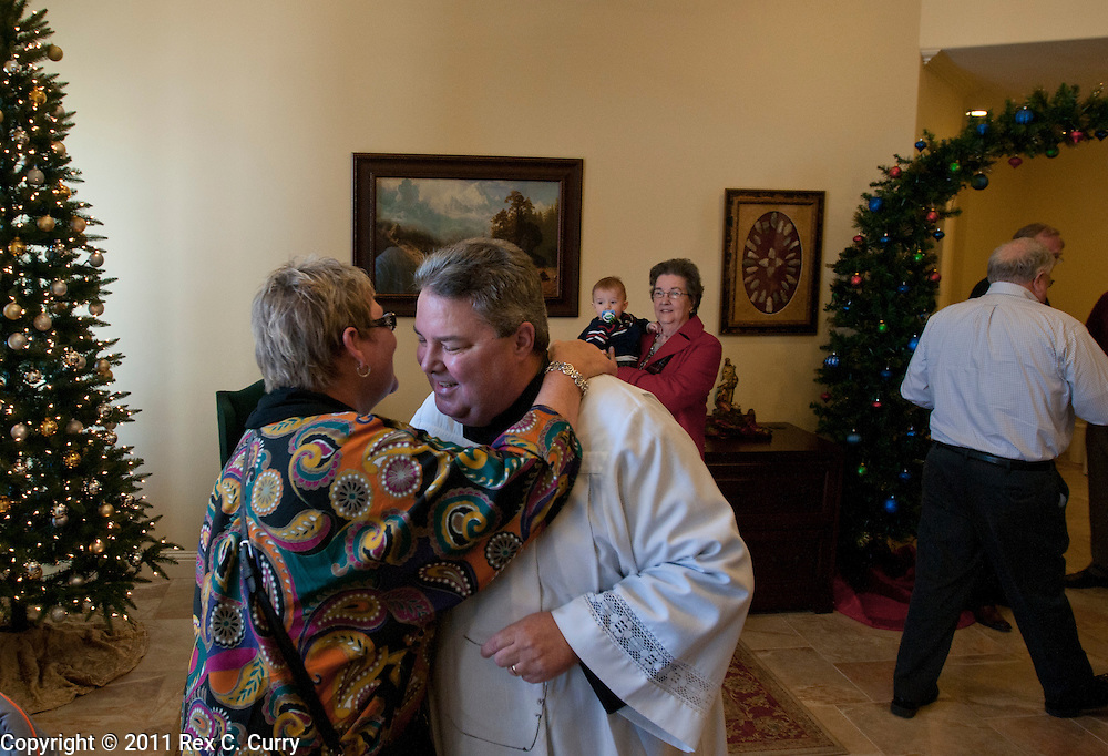 Father Charles Hough greets members of his congregation at the St. John Vianney Parish in Cleburne, Tx. Sunday Jan. 1, 2012.  .
