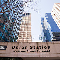 Union Station in Chicago high resolution photo. Union Station sign and entrance in Chicago with office buildings.
