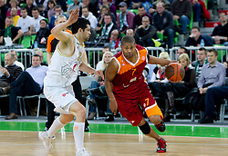 Saso Ozbolt of Olimpija vs Charles Smith of Lottomatica during basketball match between KK Union Olimpija (SLO) and Lottomatica Roma (ITA) in Group F of Top 16 Turkish Airlines Euroleague, on February 23, 2011 in Arena Stozice, Ljubljana, Slovenia.  (Photo By Vid Ponikvar / Sportida.com)