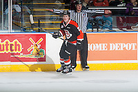 KELOWNA, CANADA - JANUARY 10: Chad Butcher #21 of Medicine Hat Tigers skates against the Kelowna Rockets on January 10, 2015 at Prospera Place in Kelowna, British Columbia, Canada.  (Photo by Marissa Baecker/Shoot the Breeze)  *** Local Caption *** Chad Butcher;