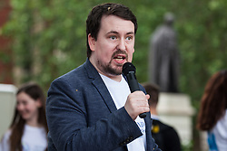 London, UK. 30 May, 2019. Dean Beadle, former journalist and SEND campaigner, addresses fellow campaigners from SEND National Crisis attending a demonstration in Parliament Square to demand improvements in the diagnosis and assessment of young people with SEND, assistance for their families, funding and legal and financial accountability for local authorities in their treatment of young people with SEND and their families.