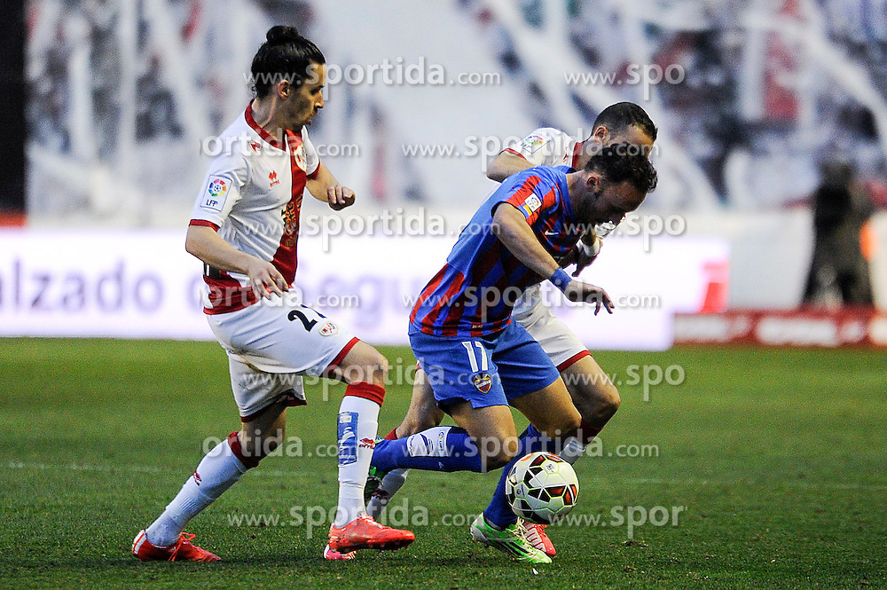 28.02.2015, Campo de Futbol, Madrid, ESP, Primera Division, Rayo Vallecano vs Levante UD, 25. Runde, im Bild Rayo Vallecano&acute;s Lica and Jose Ignacio Garcia and Levante UD&acute;s Jordi Xumetra Feliu // during the Spanish Primera Division 25th round match between Rayo Vallecano and Levante UD at the Campo de Futbol in Madrid, Spain on 2015/02/28. EXPA Pictures &copy; 2015, PhotoCredit: EXPA/ Alterphotos/ Luis Fernandez<br /> <br /> *****ATTENTION - OUT of ESP, SUI*****