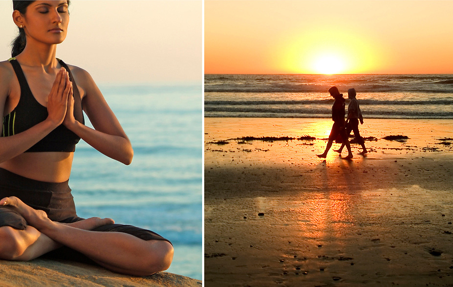 Young woman practicing meditation and couple walking on beach at sunset in Carlsbad, CA.