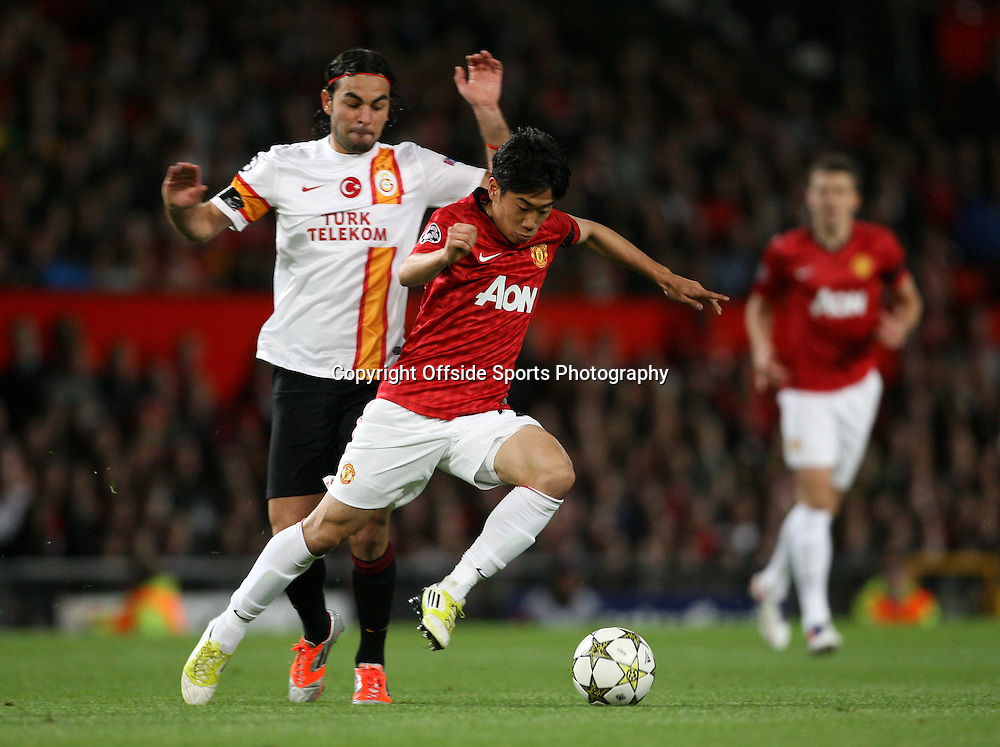 19th September 2012 - UEFA Champions League (Group H) - Manchester United vs. Galatasaray - Shinji Kagawa of Man Utd skips past Selcuk Inan of Galatasaray - Photo: Simon Stacpoole / Offside.