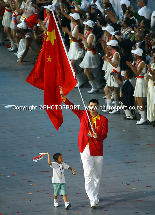 The opening ceremony of the 2008 Olympic Games in Beijing gets underway with a spectacular show introducing athletes from all over the world. The Chinese team walk in led by basketball player Yao Ming. 8 August 2008. Photo: Lawrence Smith/PHOTOSPORT