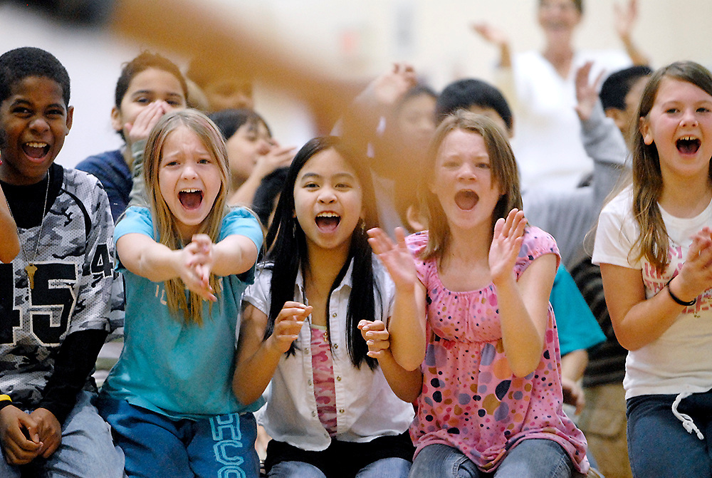 Students at Cherrydale Elementary School cheer for several of their classmates who were singing in a school wide talent show.