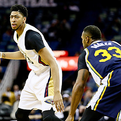 Feb 10, 2016; New Orleans, LA, USA; New Orleans Pelicans forward Anthony Davis (23) is defended by Utah Jazz forward Trevor Booker (33) during the first quarter of a game at the Smoothie King Center. Mandatory Credit: Derick E. Hingle-USA TODAY Sports