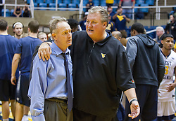 Nov 20, 2016; Morgantown, WV, USA; West Virginia Mountaineers head coach Bob Huggins speaks with New Hampshire Wildcats head coach Bill Herrion after their game at WVU Coliseum. Mandatory Credit: Ben Queen-USA TODAY Sports