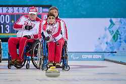 Svetlana Pakhomova, Marat Romanov. Alexander Shevchenko, Wheelchair Curling Semi Finals at the 2014 Sochi Winter Paralympic Games, Russia