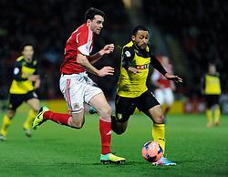 Watford's Ikechi Anya and Bristol City's Brendan Moloney give chase to a loose ball - Photo mandatory by-line: Dougie Allward/JMP - Tel: Mobile: 07966 386802 14/01/2014 - SPORT - FOOTBALL - Vicarage Road - Watford - Watford v Bristol City - FA Cup - Third Round - replay