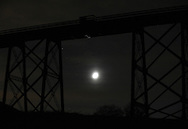 Salisbury Mills, New York  - The moon shines through clouds under the Moodna Viaduct railroad trestle on Nov. 27, 2011.