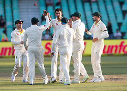 Durban. 020318.Mitchell Starc of Australia celebrates the wicket of Kagiso Rabadal of the Proteas with his team mates during day 2 of the 1st Sunfoil Test match between South Africa and Australia at Sahara Stadium Kingsmead on March 02, 2018 in Durban, South Africa. Picture Leon Lestrade/African News Agency/ANA