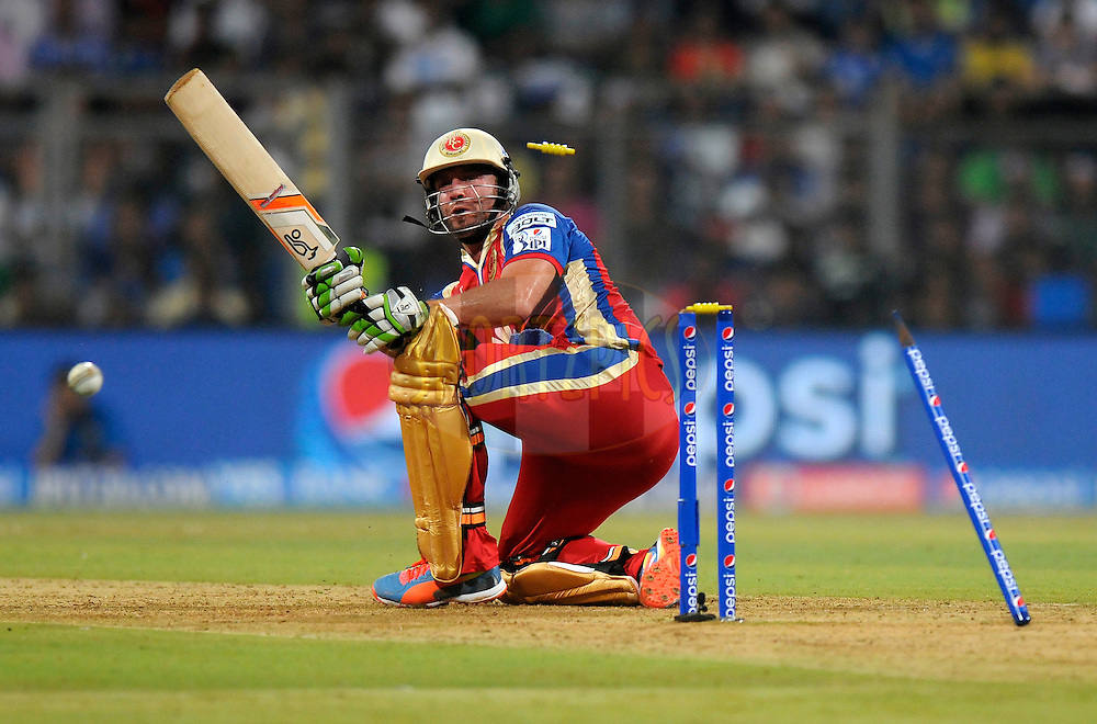 AB de Villiers of the Royal Challengers Bangalore gets bowled out by Jasprit Bumrah of the Mumbai Indians during match 27 of the Pepsi Indian Premier League Season 2014 between the Mumbai Indians and the Royal Challengers Bangalore held at the Wankhede Cricket Stadium, Mumbai, India on the 6th May  2014<br /> <br /> Photo by Pal Pillai / IPL / SPORTZPICS<br /> <br /> <br /> <br /> Image use subject to terms and conditions which can be found here:  http://sportzpics.photoshelter.com/gallery/Pepsi-IPL-Image-terms-and-conditions/G00004VW1IVJ.gB0/C0000TScjhBM6ikg