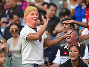A fan with a Donald Trump mask in the crowd during the Cathay Pacific/HSBC Hong Kong Sevens festival at the Hong Kong Stadium, So Kon Po, Hong Kong. on 8/04/2018. Picture by Ian  Muir.