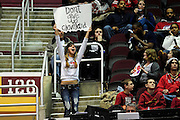 """Feb. 9, 2011; Cleveland, OH, USA; A Cleveland Cavaliers fan cheers for the team with sign reading """"Don't give up Cleveland"""" during the third quarter against the Detroit Pistons at Quicken Loans Arena. The Pistons beat the Cavaliers 103-94 for Cleveland's 26th loss in a row. Mandatory Credit: Jason Miller-US PRESSWIRE"""
