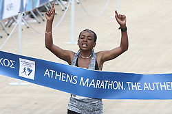 November 12, 2017 - Athens, Attica, Greece - Ethiopian Bedaru Badane finishes first in the Athens Marathon Women's race at the Panathenaic stadium in Athens, Greece, on Sunday November 12, 2017  (Credit Image: © Panayotis Tzamaros/NurPhoto via ZUMA Press)