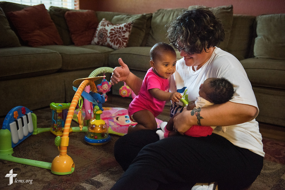 Deaconess Alyssa St. Georges of Lutheran Church of the Redeemer in Sanford, Fla., and her daughter Lylah St. Georges (standing), play with a resident mother's baby at Redeeming Life Maternity home during a Y4Life servant event on Saturday, Sept. 12, 2015, in Sanford, Fla. LCMS Communications/Erik M. Lunsford
