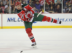 Mar 18; Newark, NJ, USA; New Jersey Devils left wing Ilya Kovalchuk (17) shoots the puck down the ice during the second period of their game against the Washington Capitals at the Prudential Center.