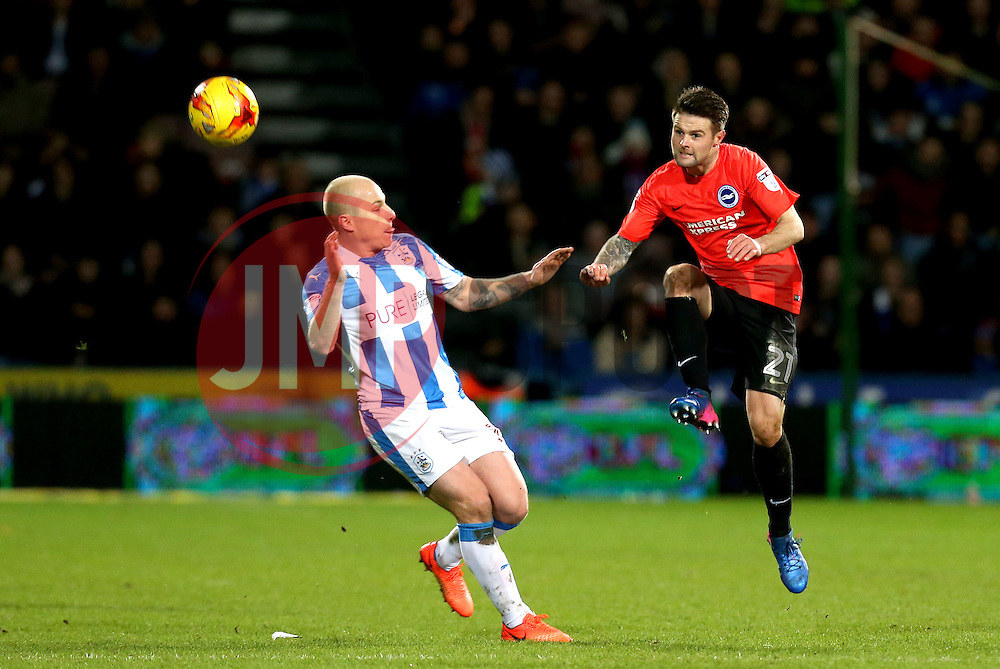 Oliver Norwood of Brighton & Hove Albion passes the ball past Aaron Mooy of Huddersfield Town - Mandatory by-line: Robbie Stephenson/JMP - 02/02/2017 - FOOTBALL - John Smith's Stadium - Huddersfield, England - Huddersfield Town v Brighton and Hove Albion - Sky Bet Championship