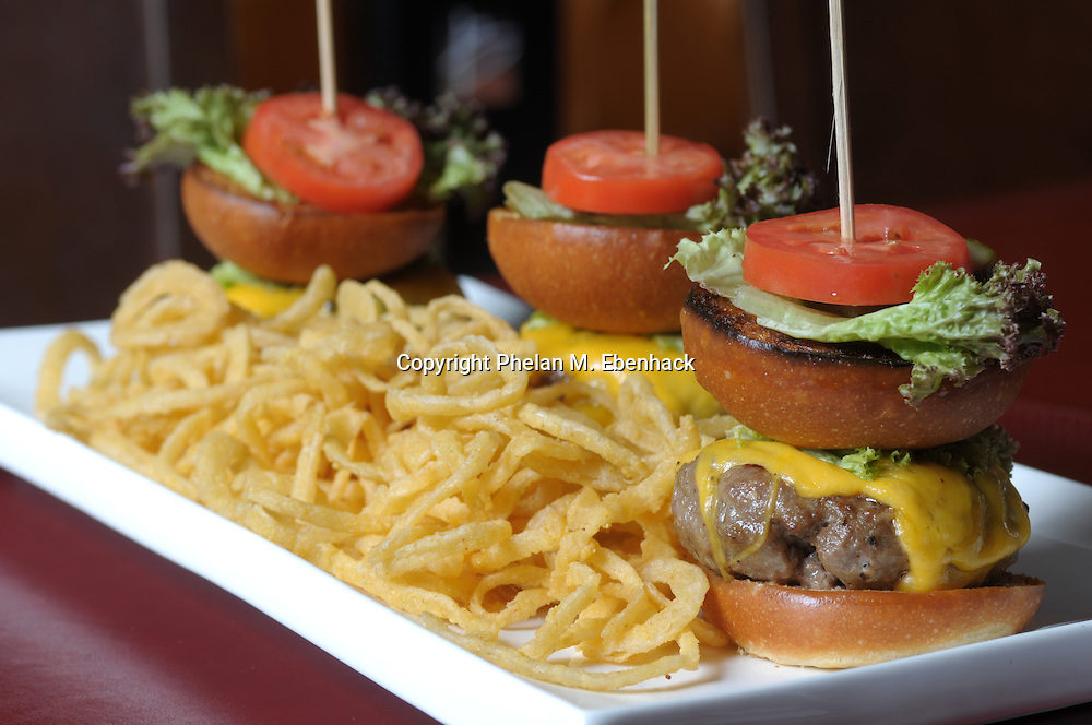 A fun serving of gourmet hamburgers with crispy vidalia onion rings in Orlando, Florida.