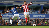 Football - 2017 / 2018 Premier League - Everton vs. Stoke City<br /> <br /> Phil Jagielka of Everton and Peter Crouch of Stoke City at Goodison Park.<br /> <br /> COLORSPORT/LYNNE CAMERON