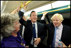 Celebration of the 2012 Olympic Games volunteering one year on. <br /> (L-R) Prime Minister of the United Kingdom David Cameron and Mayor of London Boris Johnson on the London Underground on their way to the Queen Elizabeth Olympic Park.<br /> Mayor of London Boris Johnson and Lord Coe will be taking to the stage at Go Local to encourage a new drive in volunteering one year on from the Games. Also present are multi-platinum selling pop rock band McFly; world famous comedian Eddie Izzard, Brit Award nominated The Feeling, and Britain'Got Talent winners Attraction, in addition to stars Jack Carroll and Gabz. The event will be the UKs biggest ever celebration of volunteering and first Olympic and Paralympic legacy event at Queen Elizabeth Olympic Park.<br /> London, United Kingdom<br /> Friday, 19th July 2013<br /> Picture by Andrew Parsons / i-Images