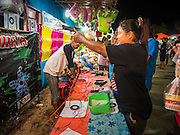 15 JUNE 2105 - NARATHIWAT, NARATHIWAT, THAILAND:  A shooting arcade game at a fair in Narathiwat to celebrate 100 years of Narathiwat. The city has been a Muslim city for centuries, but when Siam (now Thailand) annexed the three southern provinces they changed the name to Narathiwat.     PHOTO BY JACK KURTZ