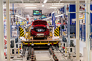 CASSINO, ITALY - NOVEMBER 24: The assembly lines where they assemble the Alfa Romeo Giulia in the Cassino Assembly Plant FCA Group on November 24, 2016 in Cassino, Italy. In this area new workstations designed to reduce fatigue and improve ergonomics have been introduced to support workers involved in the manual elements of assembly.