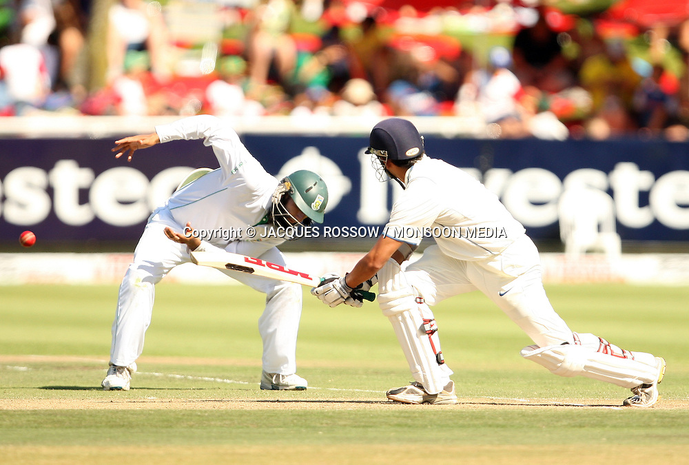 Gautam Gambir plays a shot to the side of Hashim Amla during Day 2 of the third and final Test between South Africa and India played at Sahara Park Newlands in Cape Town, South Africa, on 2 January 2011. Photo by Jacques Rossouw / MONSOON MEDIA