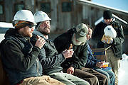 PRICE CHAMBERS / NEWS&amp;GUIDE<br /> Outside in last winter's extreme cold, Jim Wolfgang and the construction crew take a break for lunch on the job site.