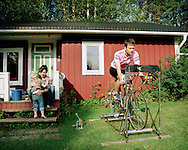 Jakob Nyström, one of two singers in band Two White Horses, on his bicycle. He owns one of the Gravmark houses together with his fiancé Lovisa Hognert and their son John. They spend summers and weekends there as often as they can. ..Lovisa Hognert och Jakob Nyström var en av de första i kompisgänget som köpte stuga i Gravmark. Här med sonen John.