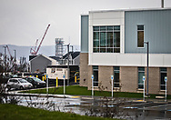 Newly built Allegheny Health Network Cancer Institute in Monaca, Pennsylvania, next to a home in a subdivision that overlooks Shell's plastics plant.