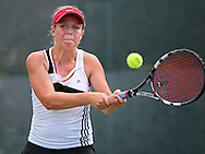 Iowa City High's Eve Small returns the ball during the Singles Draw finals match of the Class 2A state tennis tournament at Veterans Memorial Tennis Center in Cedar Rapids on Friday, May 31, 2013.