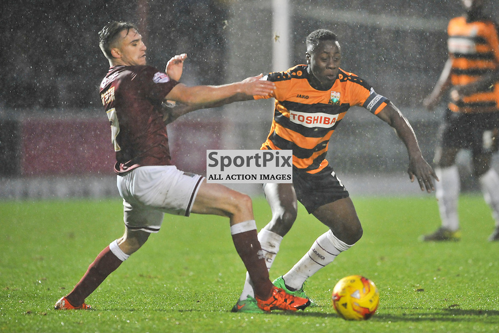 Northamptons Lawson D'Ath tackles Barnets Andy Yiadom, Northampton Town v Barnet FC, Sixfields Stadium, Sky Bet League Two, Saturday 2nd January 2016