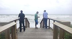 A BSO Deputy and beach-goers watch the wind and surf from Hurricane Irma at Dania Beach on Saturday, September 9, 2017, in Dania Beach, FL, USA. Photo by Joe Cavaretta/Sun Sentinel/TNS/ABACAPRESS.COM